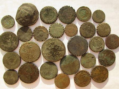 Монеты с искусственными повреждениями